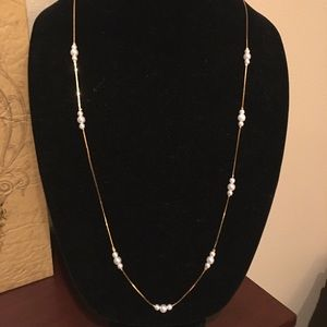Gold colored necklace with pearl stations